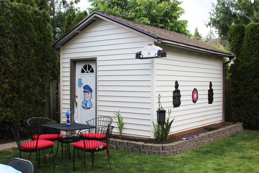 The backyard was transformed into a police training area. There was a nerf  shooting range, pin the badge on the officer, and a Police Car Pinata.