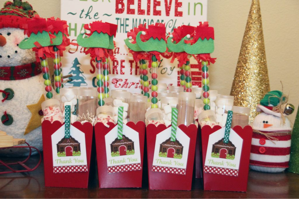Classic red popcorn boxes were paired with our printable gingerbread house favor tags for the perfect party favor. The adorable elf show candy wands are ...